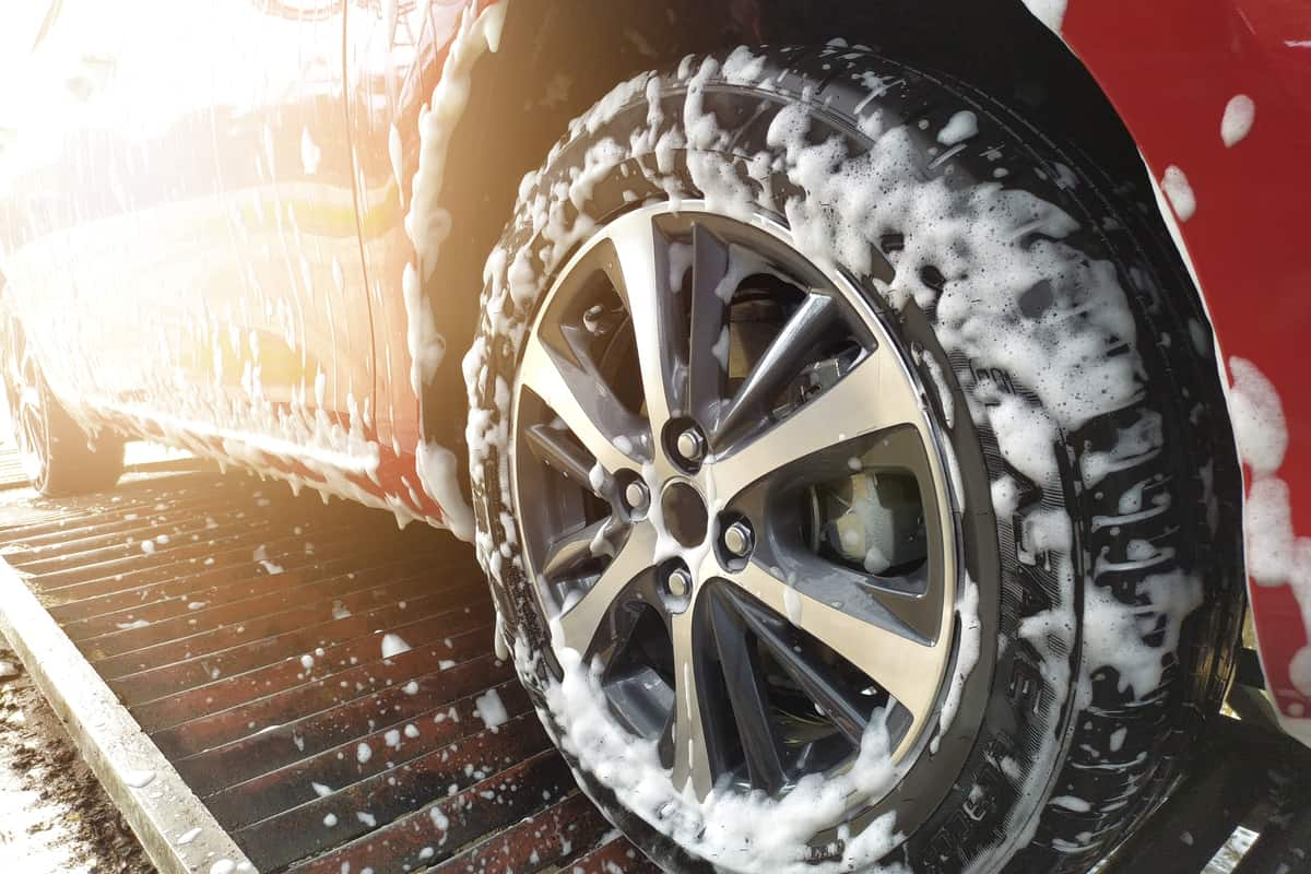 Car wheels being washed.