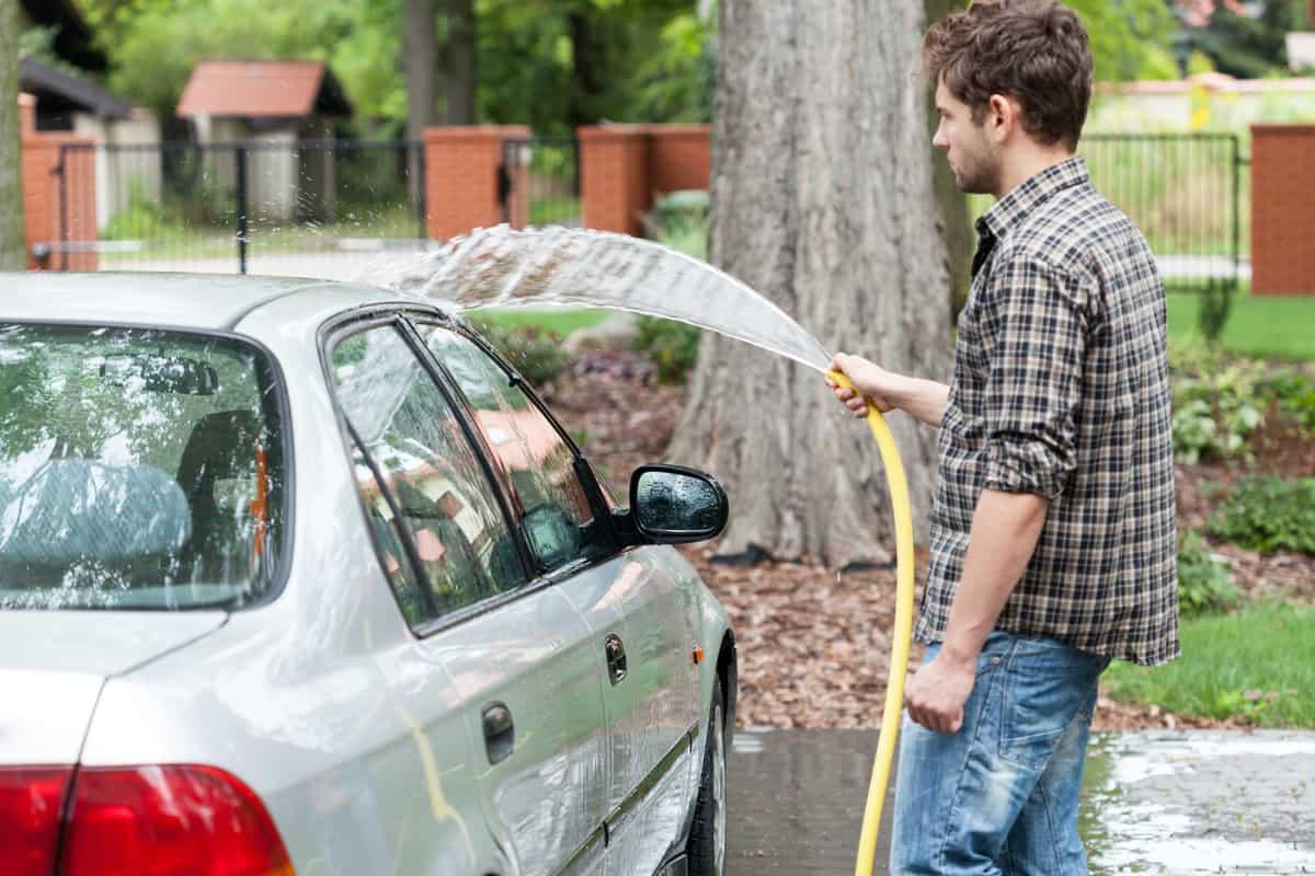 Man washing his car.