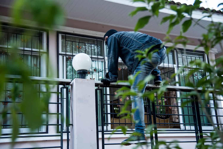 burglar climbing fence